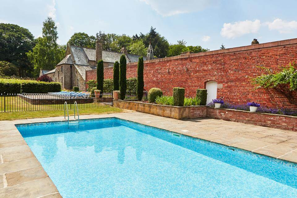 A luxurious outdoor swimming pool at Kington Lodge